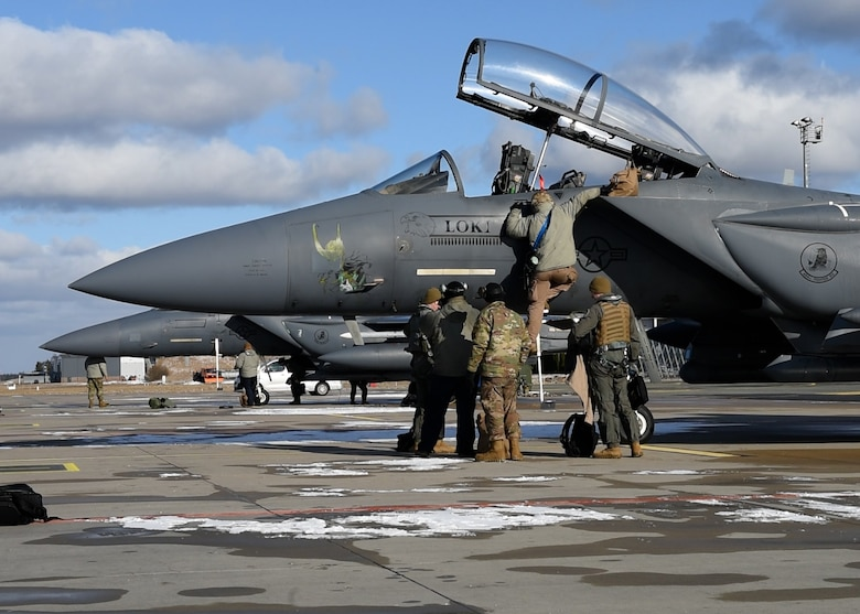 48th Aircraft Maintenance Squadron Airmen prepare an F-15E Strike Eagle to return to Royal Air Force Lakenheath, England, from Amari Air Base, Estonia after completion of Baltic Trident March 19, 2021. Baltic Trident was centered on the Agile Combat Employment concept of operations, showcasing the 48th Fighter Wing's multi-capable Airmen and their ability to effectively carry out the mission away from home station with varying levels of support and a smaller manpower footprint. (U.S. Air Force photo by Airman 1st Class Jessi Monte)