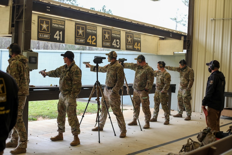 "Service Members from across the Army, Army Reserves and National Guard fire M-9 pistols during the 2021 U.S. Army ""All Army"" Small Arms Championships at Fort Benning, Georgia, March 14-20, 2021. National Guard teams and individuals brought home 23 of 31 top awards including 1st in nine of 11 categories."