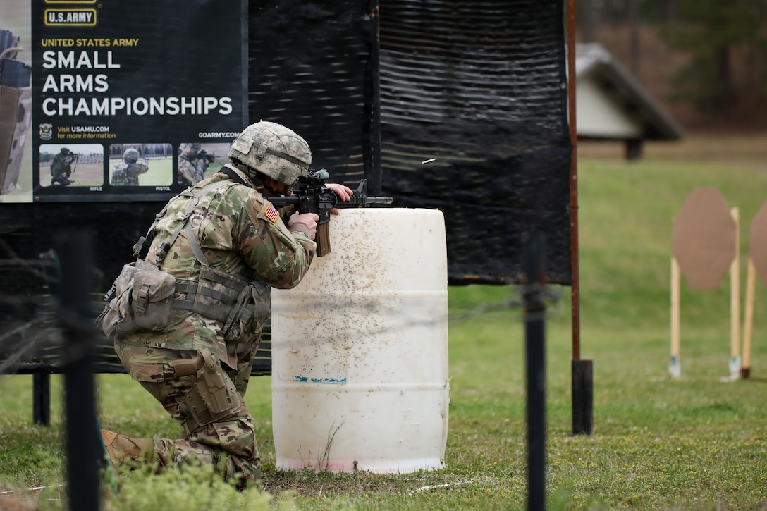 """Sgt. Jameson Nelms, with the Wisconsin National Guard's 1st Battalion, 128th Infinity, fires his M4 carbine at targets during the multi-gun match at the 2021 U.S. Army """"All Army"""" Small Arms Championships at Fort Benning, Georgia, March 14-20, 2021. National Guard teams and individuals brought home 23 of 31 top awards."""