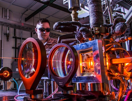 An Air Force Research Laboratory Directed Energy Directorate laser physicist analyzes the output beam from one of the directorate's advanced laser sources. AFRL scientists investigate novel laser sources that are easily maintained, environmentally friendly, and capable of high power levels. Benefits of directed energy for the warfighter include speed of light delivery, long-range engagement, low collateral damage and deep magazine. (Courtesy photo)