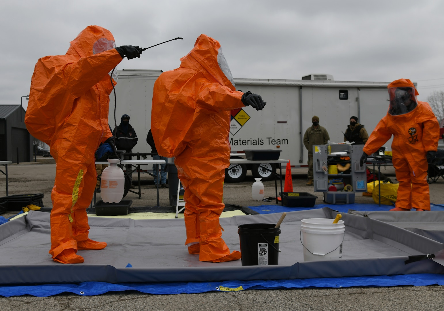 Members of the Michigan National Guard's 51st Civil Support Team run through decontamination procedures during Northern Exposure 21, March 16, 2021, at Mount Pleasant, Michigan. Northern Exposure 21 was integrated with another exercise known as Rising Waters 2021. This year's scenario was catastrophic flooding leading to chemical contamination, which was followed by a possible WMD situation.