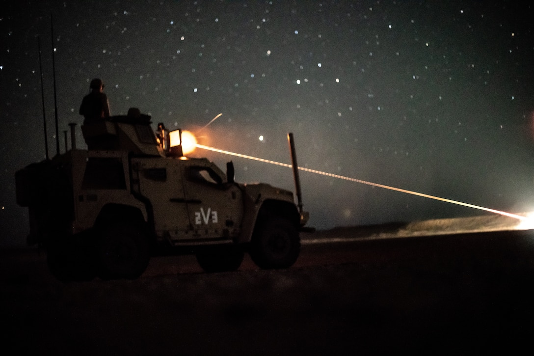 A U.S. Marine assigned to Combined Anti-Armor Team 2, Weapons Company, Battalion Landing Team 1/4, 15th Marine Expeditionary Unit, fires an M2A1 machine gun from a joint light tactical vehicle during a theater amphibious combat rehearsal in Tabuk, Kingdom of Saudi Arabia, March 8. TACR integrates U.S. Navy and Marine Corps assets to practice and rehearse a range of critical combat-related capabilities available to U.S. Central Command, both afloat and ashore, to promote stability and security in the region. The 15th MEU is deployed to the U.S. 5th Fleet area of operations in support of naval operations to ensure maritime stability and security in the Central Region, connecting the Mediterranean and Pacific through the Western Indian Ocean and three strategic choke points.
