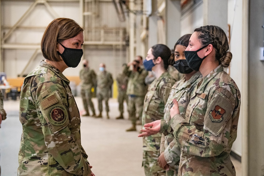 Chief Master Sergeant of the Air Force JoAnne S. Bass speaks to Airman 1st Class Brianna Cortez, 97th Logistics Readiness Squadron material manager, March 22, 2021, at Altus Air Force Base, Okla. During her visit, Bass learned about the cultures of multiple squadrons across the wing and how it enables them to deliver elite airpower, including those responsible for providing premier C-17 Globemaster III, KC-135 Stratotanker and KC-46 Pegasus aircrew training worldwide.