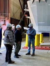 MARINETTE, Wis. (Mar. 23, 2021) - Chief of Naval Operations (CNO) Adm. Mike Gilday tours Fincantieri Marinettte Marine Shipyard with leadership from the shipyard. During the visit, CNO also received briefs on a range of topics, including the Navy's new Constellation-class Guided-Missile Frigate (FFG) and Large Unmanned Surface Vehicle (LUSV) development. (U.S. Navy photo by Cmdr. Nate Christensen/Released)