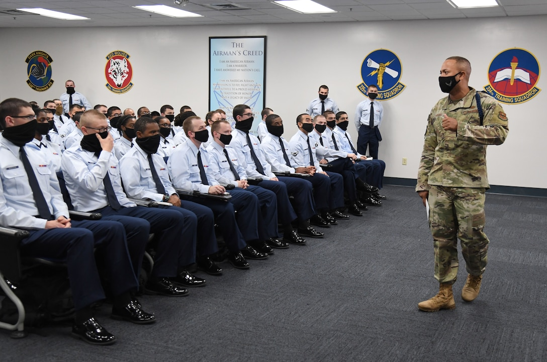 U.S. Air Force Tech. Sgt. Alvin Morris, 336th Training Squadron military training leader, conducts a professional development brief inside the Levitow Training Support Facility at Keesler Air Force Base, Mississippi, Feb. 25, 2021. The Master Military Training Leader Program, created at Keesler, was designed to distinguish the military training leaders who have mastered the demonstration, evaluation and reinforcement of military standards; exude military bearing and discipline while scheduling and conducting military training; and are key leaders among Airmen and their peers. (U.S. Air Force photo by Kemberly Groue)