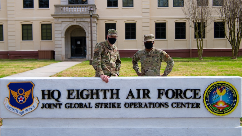 Chief Master Sgt. Melvina Smith, 8th Air Force command chief and Joint Global Strike Operations Center senior enlisted leader (right), and Tech Sgt. Adam Wilkinson, 8th Air Force and Joint Global Strike Operations Center deputy chief of nuclear command, control and communication threats (left) pose for a photo outside of the 8th Air Force headquarters building at Barksdale Air Force base, La., Feb. 23, 2021. Tech Sgt. Wilkinson had the opportunity to shadow Chief Smith for a day.  (U.S. Air Force photo by Staff Sgt. Bria Hughes)