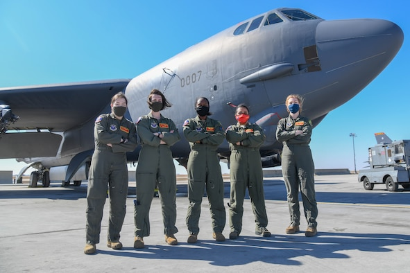 Team Minot's Female Electronic Warfare Officers and Weapons System Officers pose in front of a B-52H Stratofortress on Minot Air Force Base, North Dakota, March 18, 2021. These women call themselves the baronesses and work in the 23rd Bomb Squadron. (U.S. Air Force photo by Airman Allison Martin)