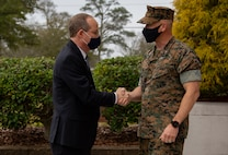 U.S. Marine Corps Col. Todd W. Ferry, right, deputy commander, Marine Corps Installations East-Marine Corps Base Camp Lejeune, greets Congressman Gregory F. Murphy, left, North Carolina's third district representative, at the John A. Lejeune Hall on MCB Camp Lejeune, North Carolina, March 23, 2021. During his visit, Murphy met with MCB Camp Lejeune leaders to receive updates on range innovations and base modernization. (U.S. Marine Corps photo by Cpl. Ginnie Lee)
