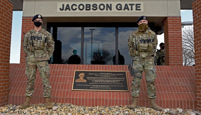 U.S. Air Force Airman 1st Class Brandon Krogman and Airman 1st Class Damian Krogman, 17th Security Forces Squadron installation entry controllers, are standing at the Jacobson Gate, on Goodfellow Air Force Base, Texas, March 16, 2021. Brandon and Damian are brothers, whose relationship created a driving force to cultivate an environment of accountability and excellence. (U.S. Air Force photo by Senior Airman Abbey Rieves)