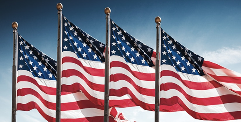 American flags against a blue sky background