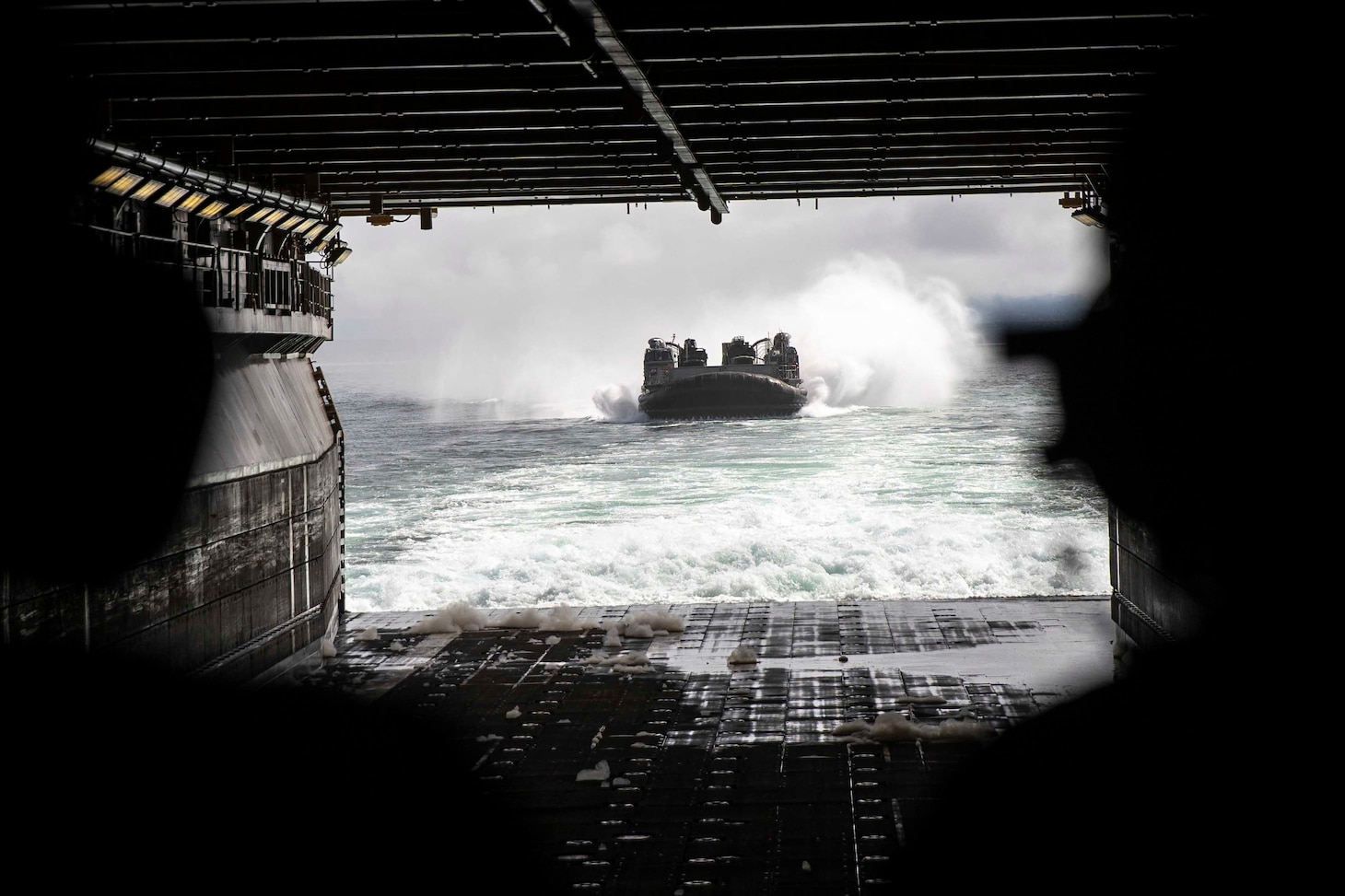 A landing craft takes to the water.