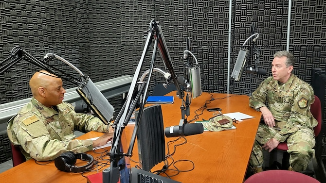 """New York Air National Guard Command Chief Master Sgt. Denny Richardson, left, speaks with Col. Rob Donaldson, the vice commander of the New York Air National Guard's 109th Airlift Wing, March 23, 2021, at Stratton Air National Guard Base near Schenectady in the first episode of his podcast, """"Journeys Through Leadership."""" Richardson, the senior enlisted leader for the New York Air National Guard, plans to use the podcast so Airmen of all ranks and experience can share their stories with others in the force."""