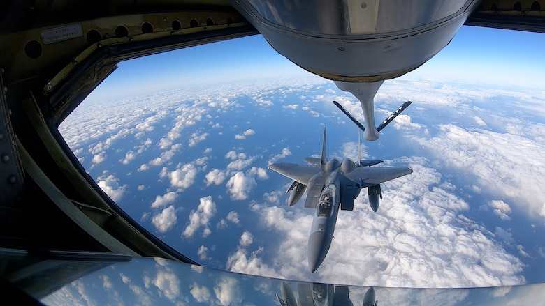 An F-15C Eagle assigned to the 493rd Fighter Squadron departs after aerial refueling during Baltic Trident, March 19, 2021. Baltic Trident was centered on the Agile Combat Employment concept of operations, showcasing the 48th Fighter Wing's multi-capable Airmen and their ability to effectively carry out the mission away from home station with varying levels of support and a smaller manpower footprint. (U.S. Air Force photo by Airman 1st Class Jessi Monte)