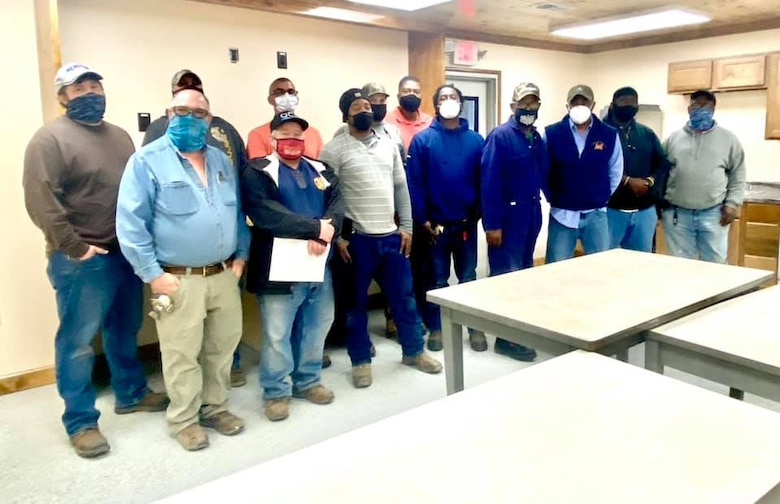 IN THE PHOTO, a team of mechanics, electricians, carpenters, pipefitters, HVAC technicians, and revetment workers all got together to completely renovate the Tractor Shop's breakroom, literally from the ground up.
