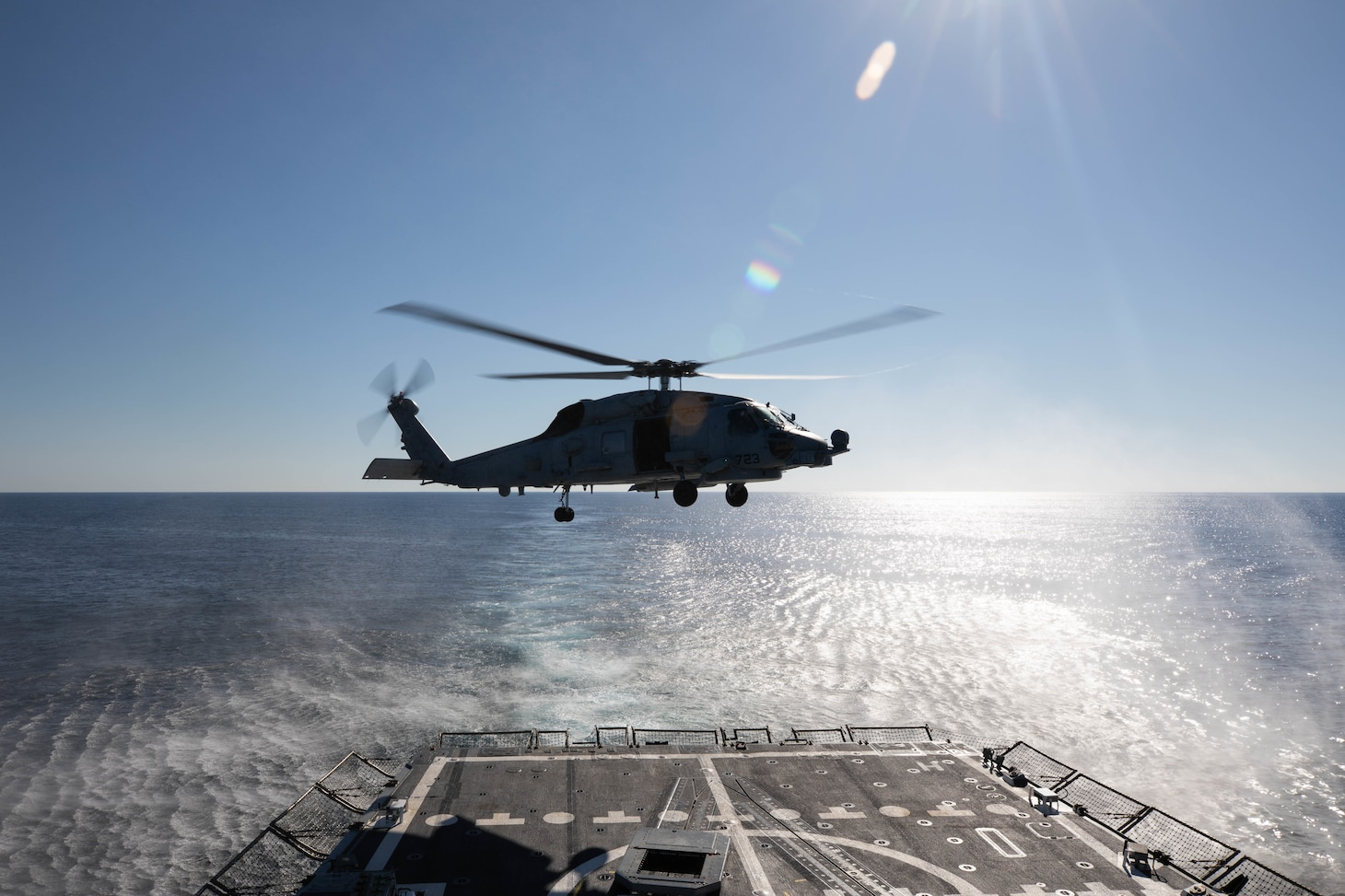 A MH-60R Seahawk helicopter, attached to the Helicopter Maritime Strike Squadron (HSM) 79, departs the flight deck of the Arleigh Burke-class guided-missile destroyer USS Roosevelt (DDG 80), March 23, 2021.
