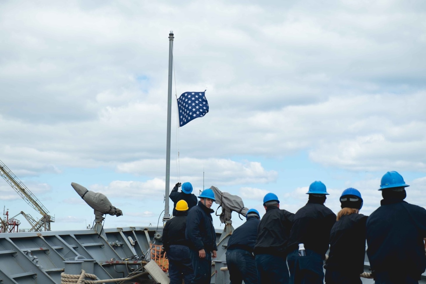 210323-N-WQ732-1063 CONSTANTA, Romania (March 23, 2021) Sailors lower the Union Jack flag and pull mooring lines aboard as the Ticonderoga-class guided-missile cruiser USS Monterey (CG 61), prepares to depart from Constanta, Romania, March 23, 2021.  Monterey is operating with the IKE Carrier Strike Group on a routine deployment in the U.S. Sixth Fleet area of operations in support of U.S. national interests and security in Europe and Africa. (U.S. Navy photo by Mass Communication Specialist Seaman Chelsea Palmer/Released)