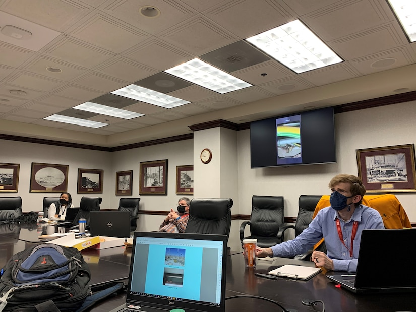 A team from the U.S. Army Corps of Engineers Memphis District meeting for the real time walk through assessment of the Imam Ali Air Base control tower in Iraq.  From left to right (Michelle Williams-Newsom - Senior Architect, David Wilson - Senior Electrical Engineer, Robert Turnage - Mechanical and Electrical Section Chief.
