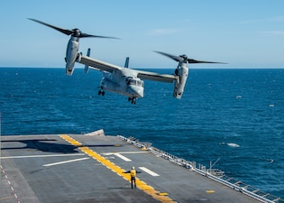 An MV-22 Osprey tiltrotor aircraft takes off from the flight deck of  USS Essex (LHD 2).