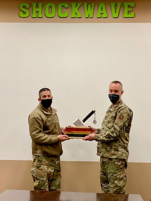 Col Aaron Cowley presents the MPoY Spirit Award to Lt. Col. Ken Howell, commander of the 705 MUNS.