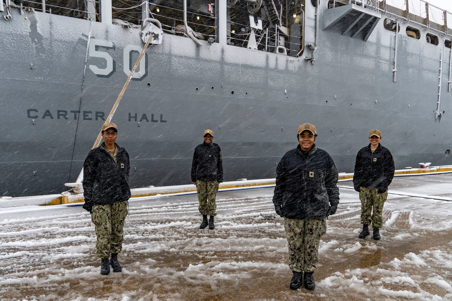 JOINT EXPEDITIONARY BASE LITTLE CREEK, Va. (Jan. 28, 2021) - Cmdr. Kimberly Jones, commanding officer of the Whidbey Island-class dock landing ship USS Tortuga, Cmdr. LaDonna Simpson, commanding officer of the Harpers Ferry-class dock landing ship USS Carter Hall (LSD 50), Cmdr. Kathryn Wijnaldum,  commanding officer of the Harpers Ferry-class dock landing ship USS Oak Hill (LSD 51),  and Cmdr. Kristel O'Canas, commanding officer of the Whidbey Island-class dock landing ship USS Whidbey Island (LSD 41) pose for a photo in front of Carter Hall, Jan. 28, 2021. (U.S. Navy photo by Mass Communication Specialist 2nd Class John D. Bellino/Released)