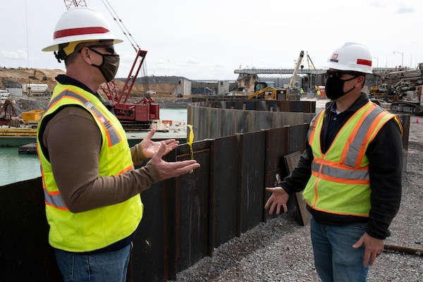 Barney Schulte (Left), lead engineer for the Kentucky Lock Addition Project, confers with Jody Robinson, Contract Team lead at Western Kentucky Area Office, while standing on top of the completed cofferdam at the Kentucky Lock Addition Project March 22, 2021 on the Tennessee River in Grand Rivers, Kentucky. The U.S. Army Corps of Engineers Nashville District is constructing a new 110-foot by 1,200-foot navigation lock at the Tennessee Valley Authority project. (USACE Photo by Lee Roberts)