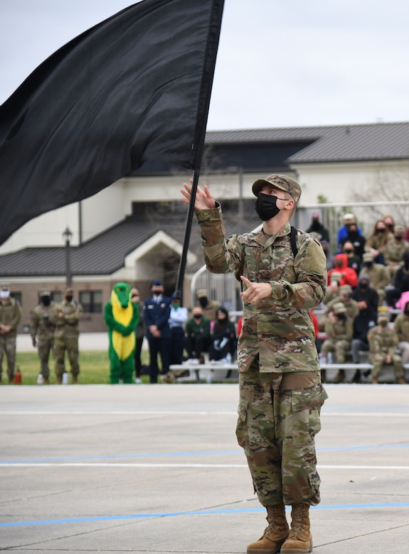 U.S. Air Force Airman Brett Livingston, 338th Training Squadron freestyle drill team member, performs during the 81st Training Group drill down on the Levitow Training Support Facility drill pad at Keesler Air Force Base, Mississippi, March 19, 2021. Airmen from the 81st TRG competed in a quarterly open ranks inspection, regulation drill routine and freestyle drill routine. Keesler trains more than 30,000 students each year. While in training, Airmen are given the opportunity to volunteer to learn and execute drill down routines. (U.S. Air Force photo by Kemberly Groue)