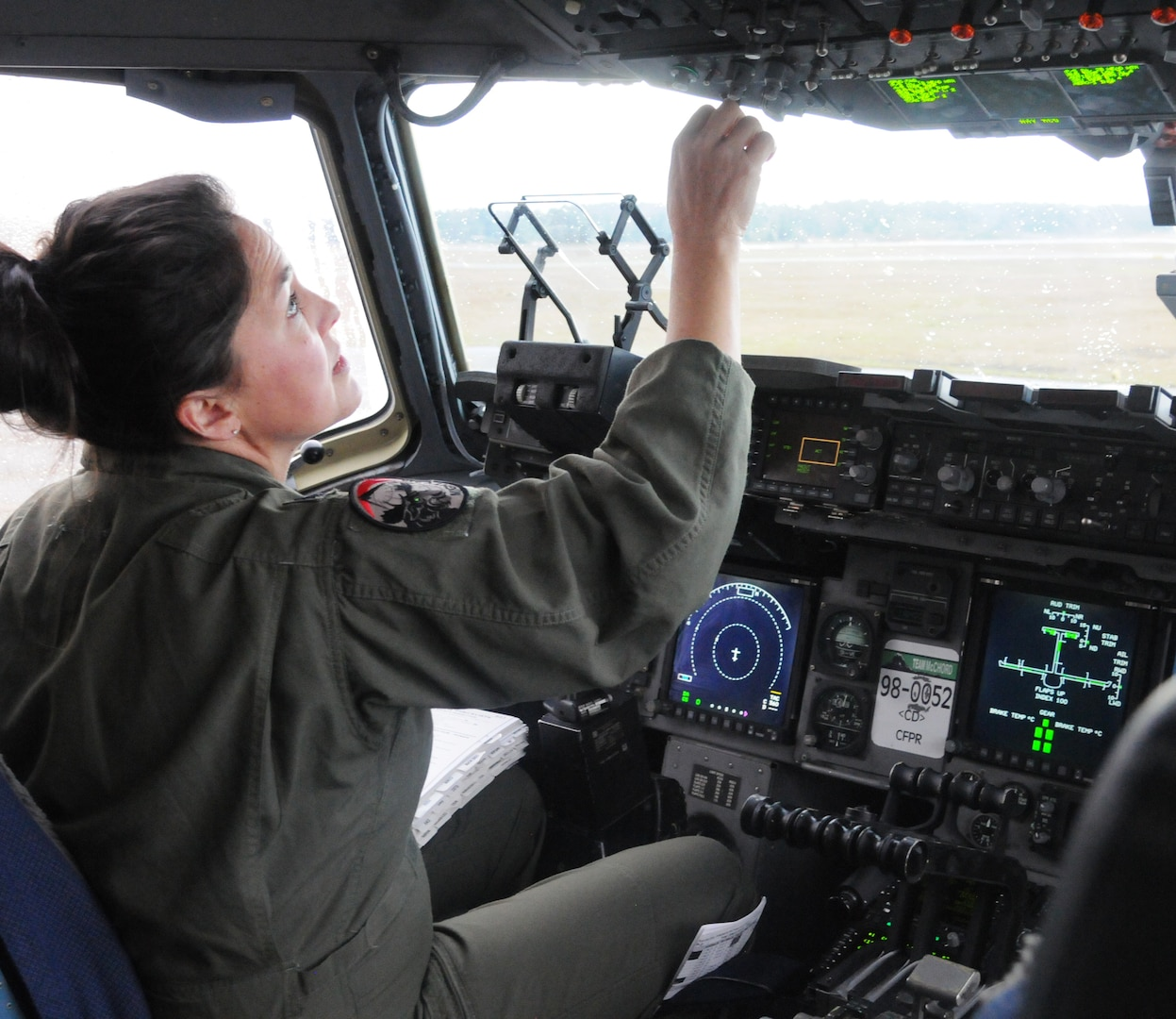 Lt. Col. Stephanie Severe, an Air Force Reserve pilot assigned to the 313th Airlift Squadron here, performs pre-flight checks before take off in a C-17 Globemaster III on March 15, 2021.