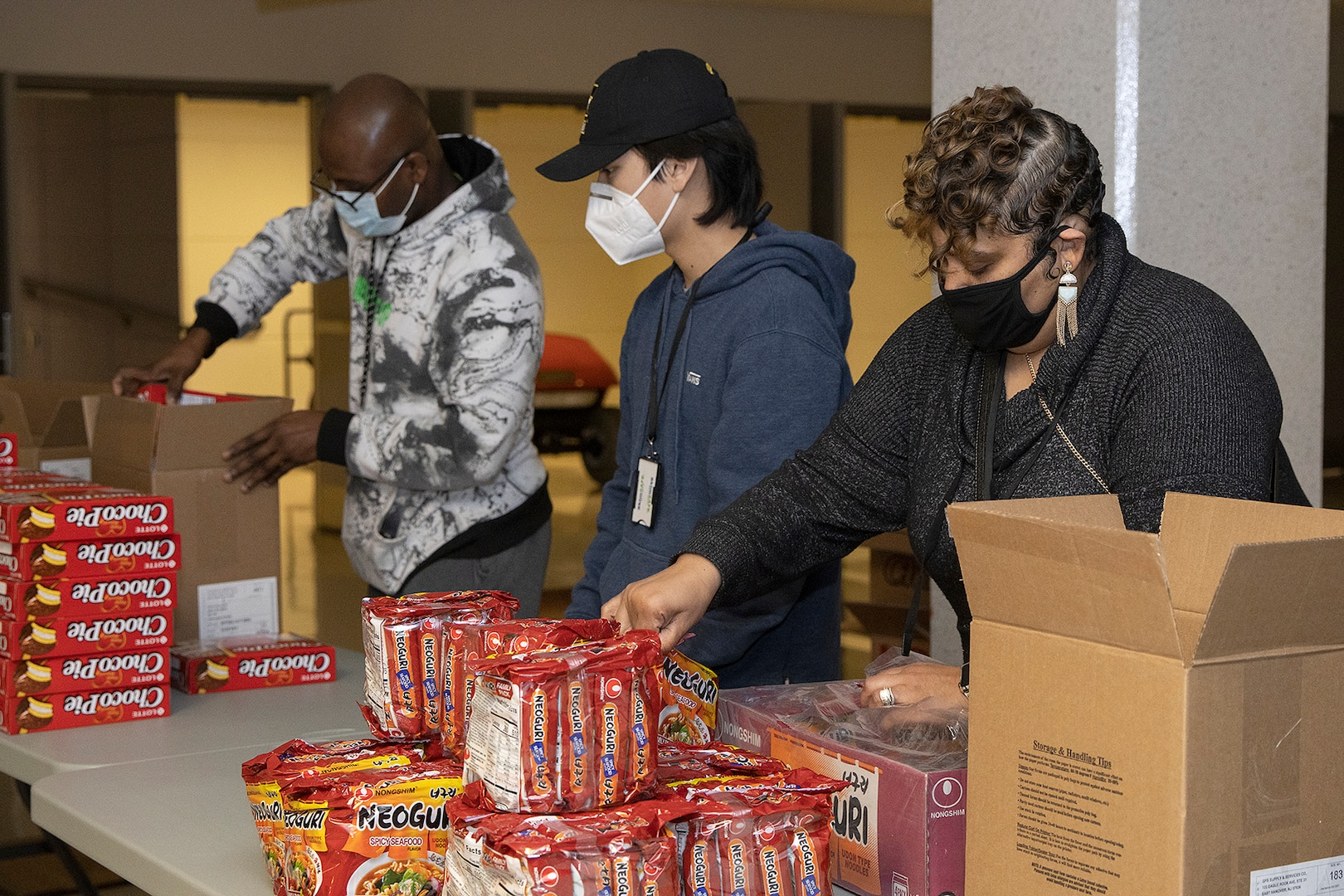 Shani Adams-Houston, right, wife of Ronald Houston, U.S. Army Financial Management Command Army Military Pay Office site captain, load up Soldier care packages at the Maj. Gen. Emmett J. Bean Federal Center in Indianapolis March 6, 2021. Houston joined Army Soldiers, civilian employees, veterans and retirees to make care packages, which will be sent to deployed Soldiers of the U.S. Army Reserve's 310th Expeditionary Sustainment Command. (U.S. Army photo by Mark R. W. Orders-Woempner)