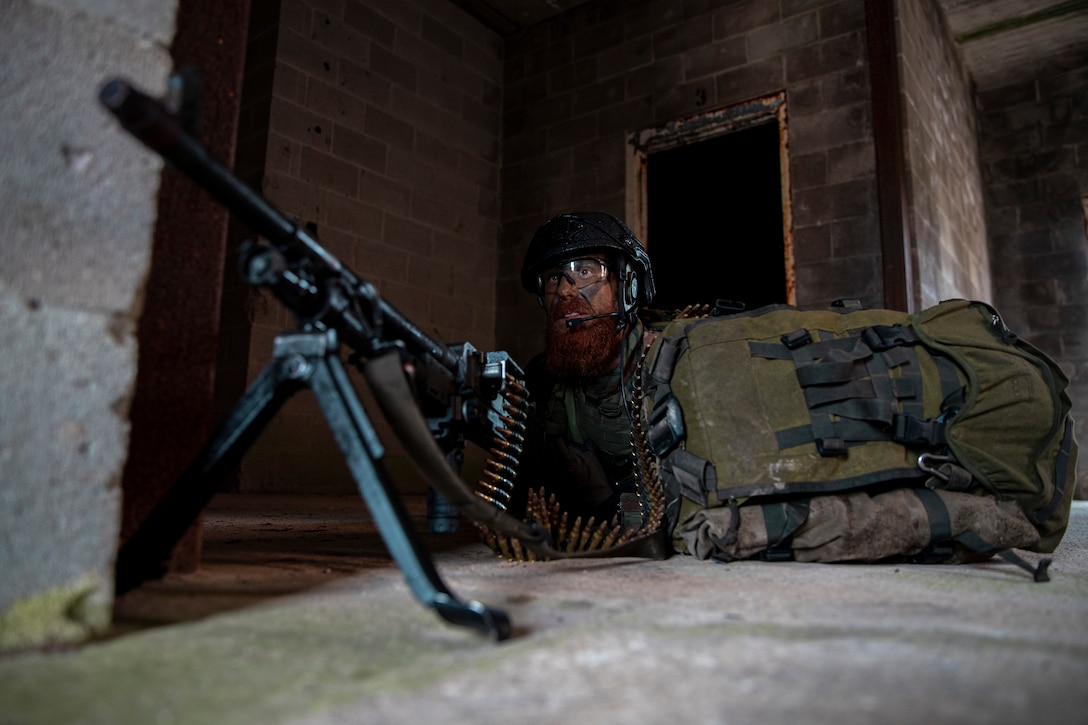 A Dutch Marine with 32nd Raiding Squadron posts security during Exercise Caribbean Urban Warrior on Camp Lejeune, N.C., March 22, 2021. The exercise is a bilateral training evolution designed to increase global interoperability between 2d Reconnaissance Battalion, 2d Marine Division and 32nd Raiding Squadron, Netherlands Marine Corps. (U.S. Marine Corps photo by Lance Cpl. Jacqueline Parsons)