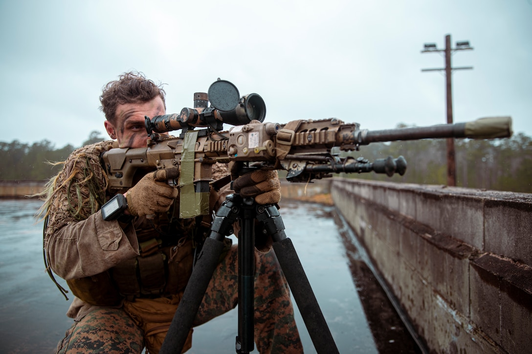 U.S. Marine Corps Cpl. Reed Bunyard, a native of Columbia, Md., and a reconnaissance Marine with 2d Reconnaissance Battalion (Recon Bn.), 2d Marine Division, posts security during Exercise Caribbean Urban Warrior on Camp Lejeune, N.C., March 22, 2021.