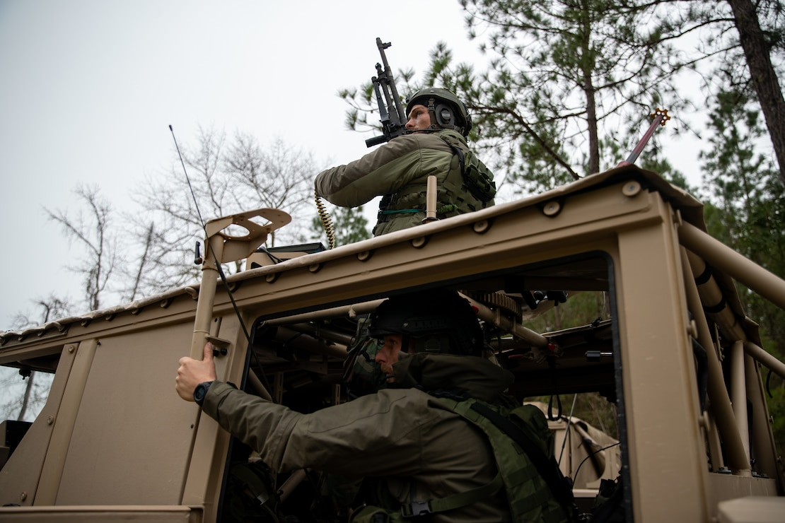 Dutch Marines with 32nd Raiding Squadron conduct a vehicle assault on an objective during Exercise Caribbean Urban Warrior on Camp Lejeune, N.C., March 23, 2021. The exercise is a bilateral training evolution designed to increase global interoperability between 2d Reconnaissance Battalion, 2d Marine Division and 32nd Raiding Squadron, Netherlands Marine Corps. (U.S. Marine Corps photo by Lance Cpl. Jacqueline Parsons)