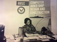 Raye Montague at her desk.