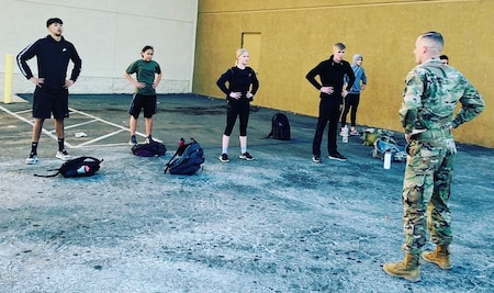 Staff Sgt. Ryan Skorker, right, leads Hesperia, Calif. Future Soldiers in physical fitness routines near the local recruiting station in March, 2021.