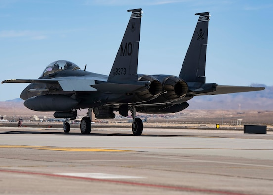 A fighter jet taxis down the flightline