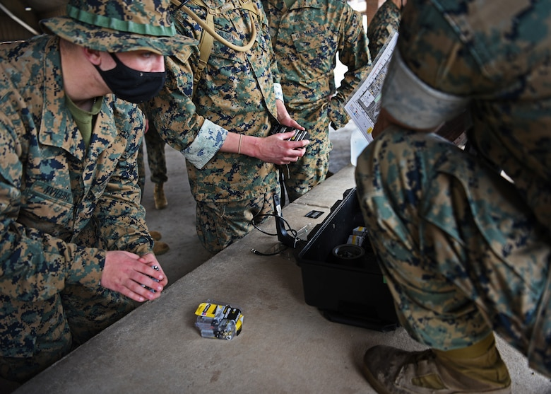 U.S. Marine Corps Tactical Signals Intelligence Operator course students from the Marine Corps Detachment, prepare intelligence equipment for a field exercise outside of the MCD dormitories on Goodfellow Air Force Base, Texas, March 22, 2021. This field training was designed to deliver technically proficient, combat capable Marines to operating forces and supporting establishments. (U.S. Air Force photo by Senior Airman Abbey Rieves)