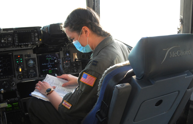 Capt. Rachel Sallee, a pilot assigned to the 728th Airlift Squadron, performs pre-flight checks before takeoff in a C-17 Globemaster III March 11 at McChord Field, Washington.