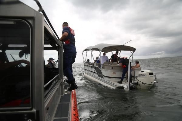 A Coast Guard Station St. Petersburg 29-foot Response Boat – Small II boat crew approaches the 27-foot boat Aug. 31, 2020, to conduct a safety boarding. Federal law requires uninspected passenger vessels to carry only a maximum of six passengers for hire with a Merchant Mariner Credential. Bareboat charters, when properly applied, transfer complete ownership of a vessel to the charterer as a recreational vessel. (U.S. Coast Guard photo by Petty Officer 3rd Class Erik Villa Rodriguez)