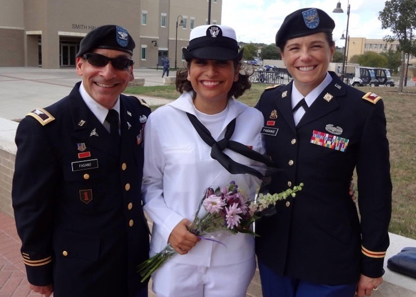 Then-Col. Cheryn L. Fasano (right), now brigadier general and the deputy commander of the 377th Theater Sustainment Command, poses with her stepdaughter Navy Seaman Gabriella Fasano and her husband Col. John Fasano after her the seaman's graduation from Navy boot camp.