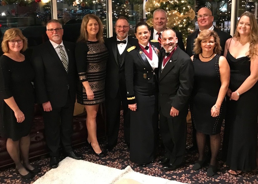 Army Reserve Brig. Gen. Cheryn L. Fasano stands front and center with her husband, retired Army Col. John Fasano, and her classmates from the Indiana University-Purdue University Reserve Officer Training Corps program, and their spouses.