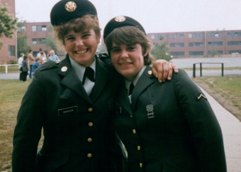 Then-Army Reserve Pvt. Cheryn L. Swanson (left), the future Brig. Gen. Cheryn L. Fasano, smiles for the camera with a battle buddy after her graduation from Basic Combat Training.