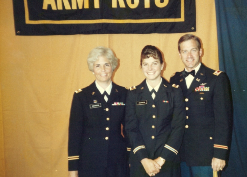 Then-2nd Lt. Cheryn L. Swanson, stands with her Army officer parents, Carol and Chuck, upon her May 1989 commissioning through the Indiana University-Perdue University Reserve Officer Training Corps program.