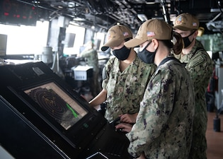 Sailors stand watch aboard USS San Diego (LPD 22) while transiting the Strait of Hormuz.