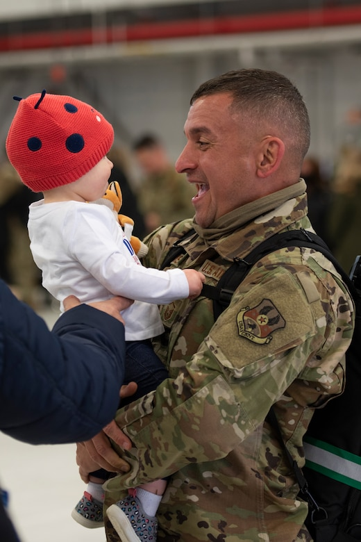 Master Sgt. David Harrison, a network systems operator, assigned to the Ohio National Guard's 180th Fighter Wing, hold his daughter after returning home from their overseas deployment, Jan. 26, 2020 at the 180FW in Swanton, Ohio.