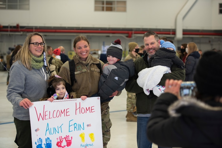 Staff Sgt. Erin Luke, a weapons technician, assigned to the Ohio National Guard's 180th Fighter Wing, poses for a photo with family members after being welcomed home from their overseas deployment, Jan. 26, 2020 at the 180FW in Swanton, Ohio.