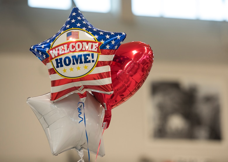 Friends and family bring balloons to welcome Airmen home from deployment, Jan. 26, 2020 at the 180FW in Swanton, Ohio.