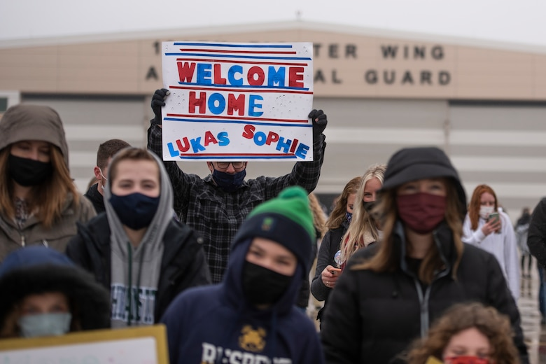 Family members await the return Airmen after an overseas deployment, Jan. 26, 2020 at the 180FW in Swanton, Ohio.