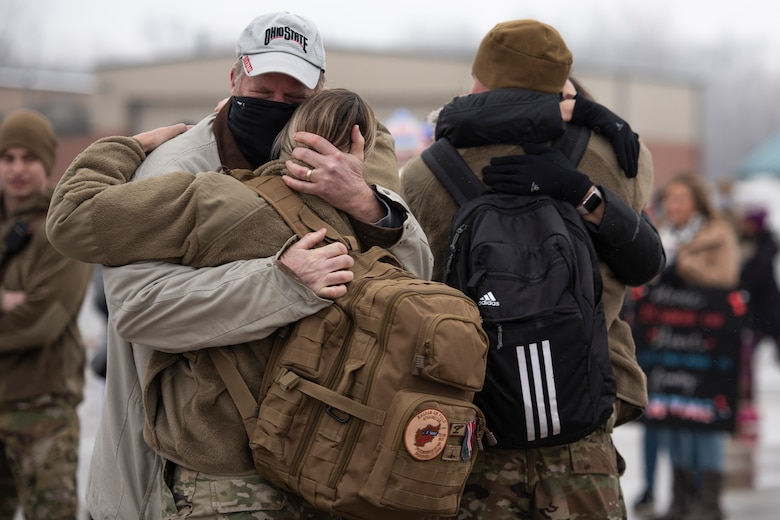 Staff Sgt. Courtney Iannucci, an intelligence specialist, and Staff Sgt. Alex Iannucci, a crew chief, assigned to the Ohio National Guard's 180th Fighter Wing, embrace loved ones after returning home from their overseas deployment, Jan. 26, 2020 at the 180FW in Swanton, Ohio.