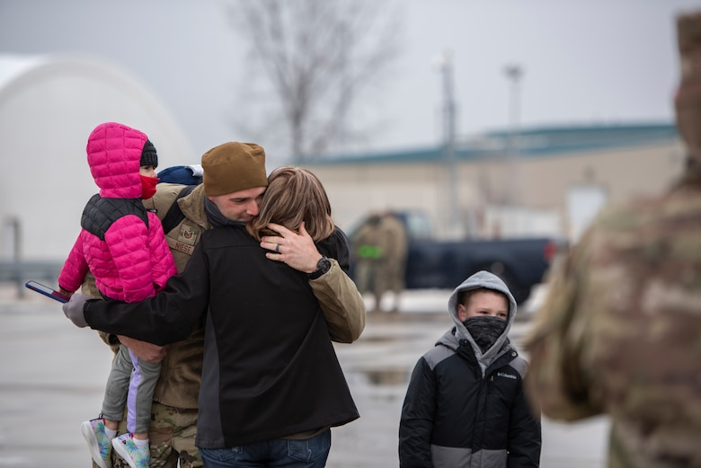 A U.S. Airman, assigned to the Ohio National Guard's 180th Fighter Wing, embraces a loved one after returning home from an overseas deployment, Jan. 26, 2020 at the 180FW in Swanton, Ohio.