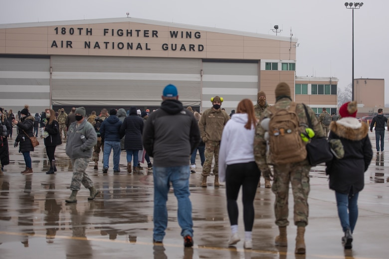 Friends and family walk to the hanger with Airmen who have returned home from their overseas deployment, Jan. 26, 2020 at the 180FW in Swanton, Ohio.