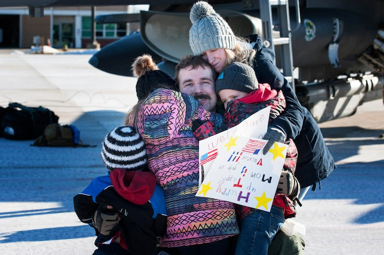 U.S. Air Force F-16 Fighting Falcon pilot, Maj. Tapper Moore, assigned to the Ohio National Guard's 180th Fighter Wing, greets his family for the first time after returning home from a three-month Aerospace Expeditionary Force deployment to Bagram Air Base, Afghanistan, Jan. 23, 2021.
